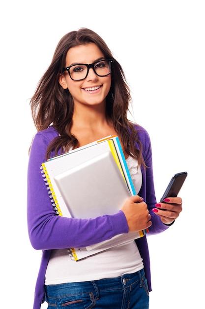 Retrato de estudante feliz em mobilidade Foto gratuita
