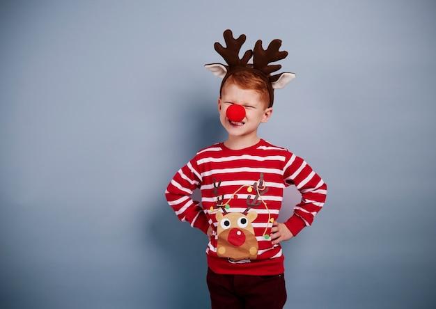 Retrato de menino fantasiado de natal Foto gratuita