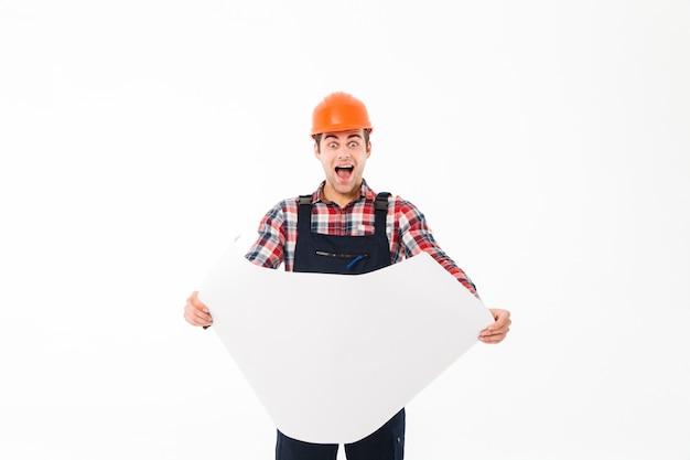 Retrato de um construtor masculino animado feliz Foto gratuita