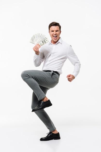 Retrato de um homem feliz e bem sucedido Foto gratuita