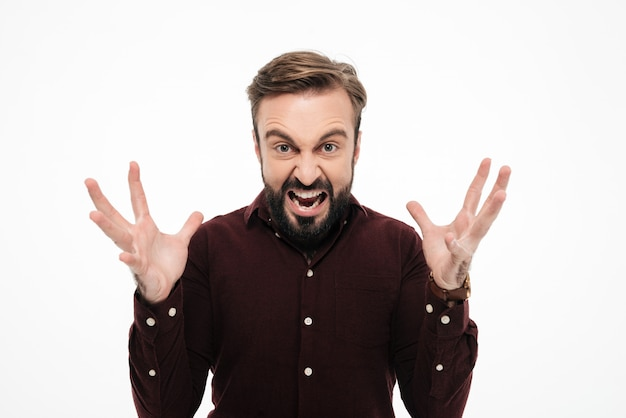 Retrato de um homem furioso irritado gritando Foto gratuita