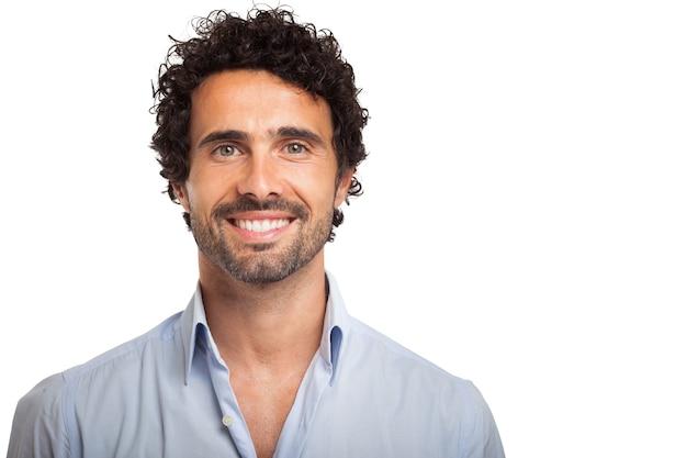 Retrato, de, um, sorrindo, homem jovem Foto Premium