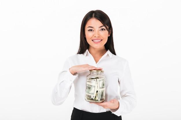 Retrato de uma mulher de negócios asiática confiante segurando o frasco Foto gratuita