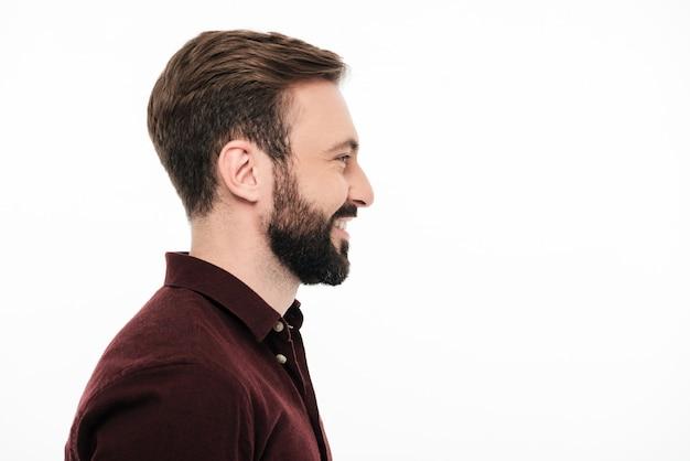 Retrato de vista lateral de um homem feliz e sorridente Foto gratuita