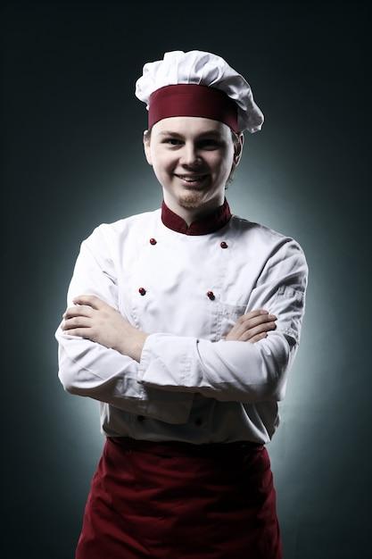 Retrato do chef sorridente Foto gratuita