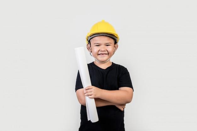 Retrato, feliz, menino, desgastar, engenheiro, chapéu Foto gratuita