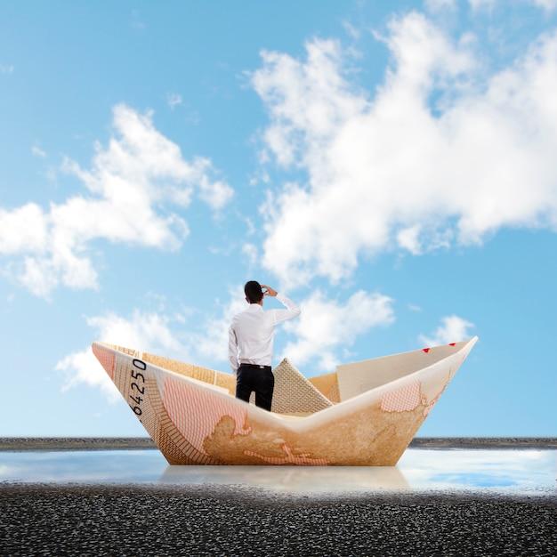 Retrovisor do empresário em um barco de papel Foto gratuita