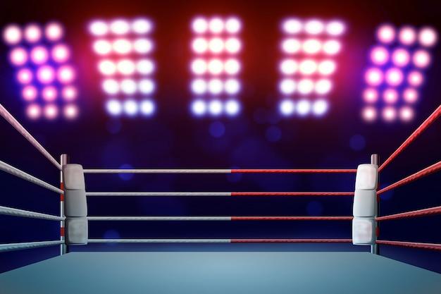 Ringue de boxe com iluminação por holofotes. Foto Premium