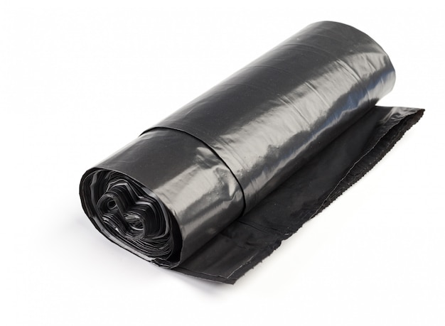 Rolo de sacos de lixo de plástico isolado no branco Foto Premium