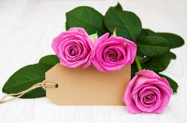 Rosas com um cartão Foto Premium