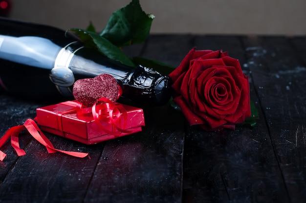 Rosas dia dos namorados e champanhe Foto Premium