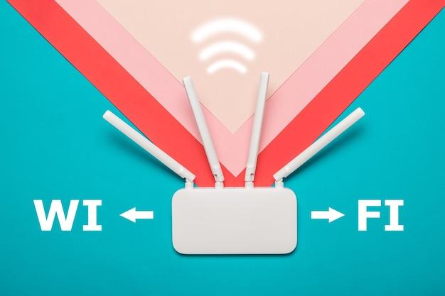Roteador wi-fi com um ícone de sinal em um fundo multicolorido. organização de redes sem fio. Foto Premium