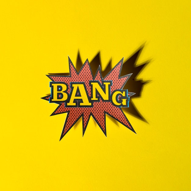 Rotulação bang boom star com sombra no fundo amarelo Foto gratuita