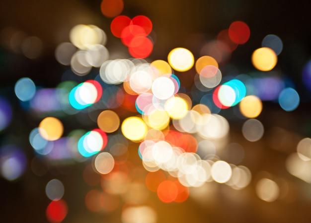 Rua da cidade à noite ilumina o fundo do bokeh Foto Premium
