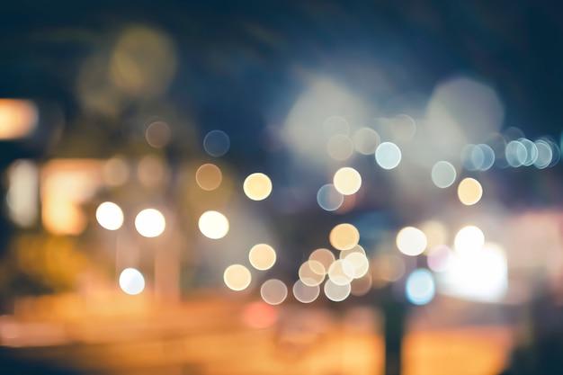Rua da cidade de noite ilumina fundo de bokeh, luzes turva bokeh de fundo Foto Premium