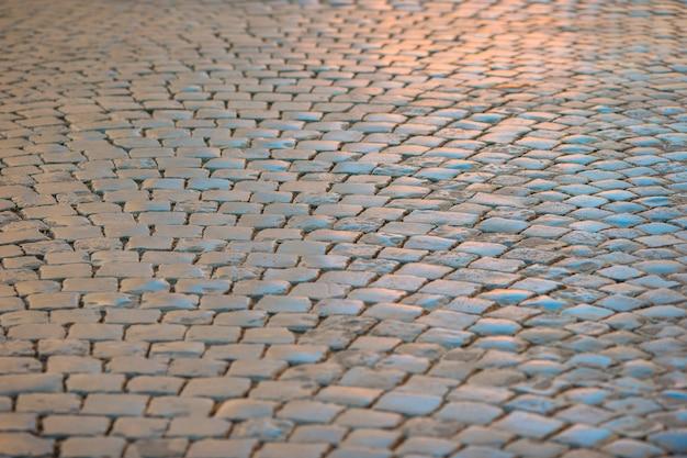 Rua romana antiga iluminada por um sol do fim da tarde. Foto Premium