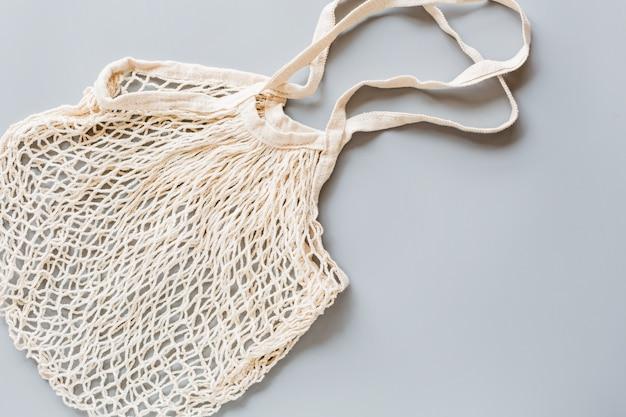 Saco de cordas ecológico branco em papel cinzento Foto Premium