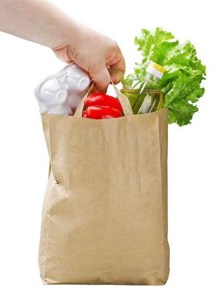 Saco de papel com comida na mão Foto Premium