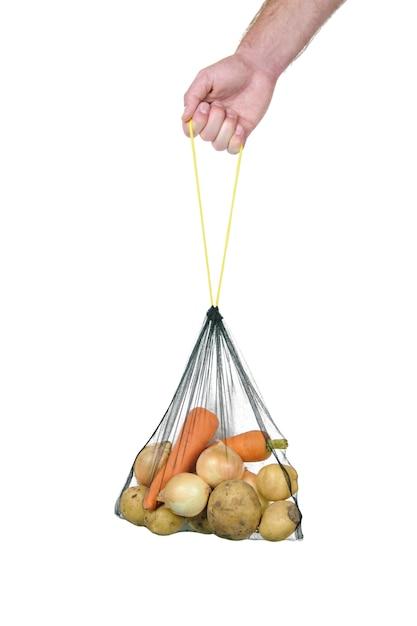 Saco de supermercado eco com legumes na mão em branco Foto Premium