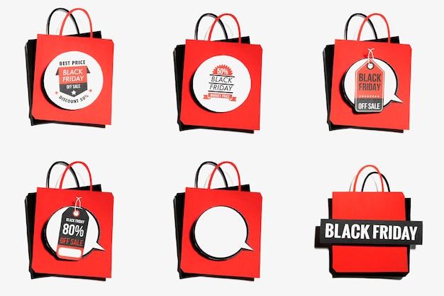 Sacola vermelha com ofertas de sexta-feira negra Foto gratuita