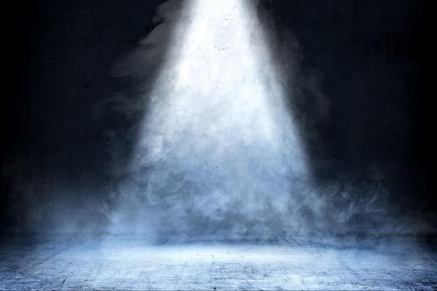 Sala com piso de concreto e fumaça com luz de cima, fundo Foto Premium