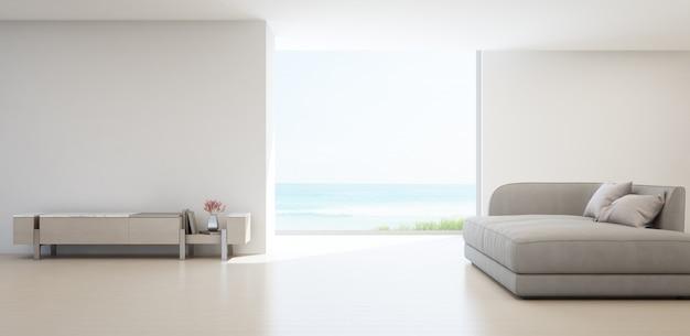 Sala de estar com vista para o mar da casa de praia de verão de luxo com suporte de tv e armário de madeira. Foto Premium