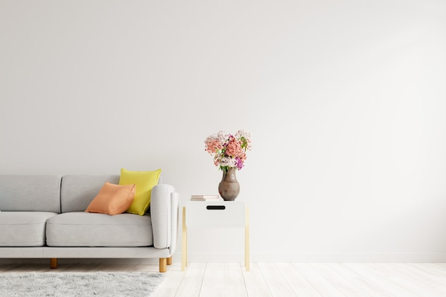 Sala de estar vazia com sofá de cor cinza, vaso de flores ornamentais na mesa com parede branca vazia. renderização 3d Foto Premium