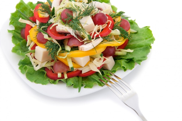 Salada e garfo. Foto Premium