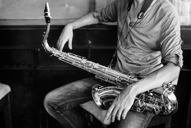 Saxophone symphony musician jazz instrument concept Foto gratuita