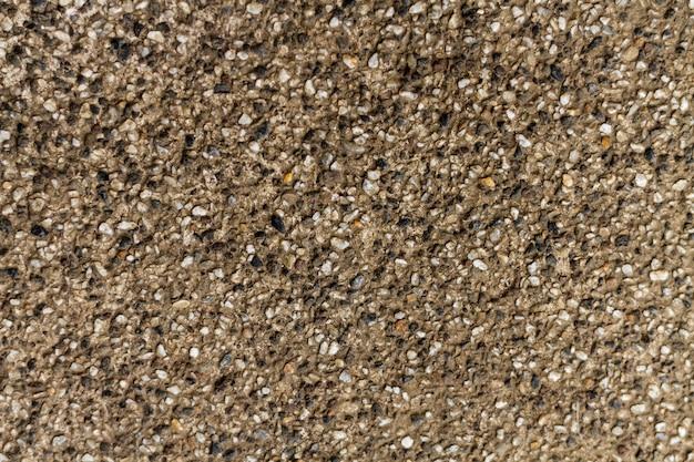 Seixos de rocha natural textura de parede de concreto Foto gratuita