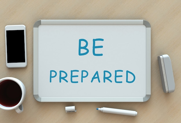Seja preparado, mensagem no quadro branco, telefone inteligente e café na mesa Foto Premium
