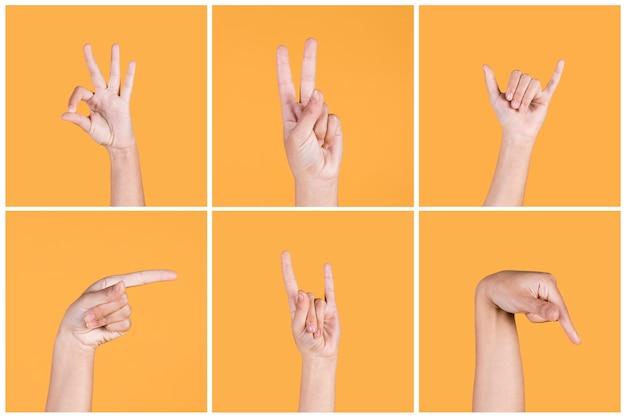 Série da mão humana que gesticula a língua de sinal surda sobre o fundo amarelo Foto gratuita