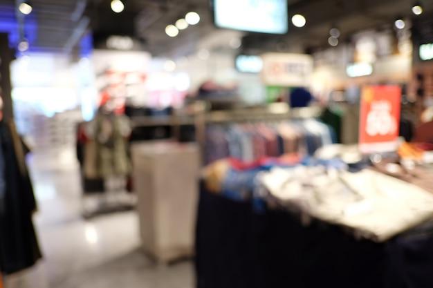 Shopping interior do borrão abstrato do armazém. Foto Premium
