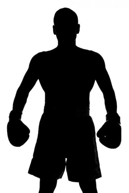 Silhueta de um homem com luvas de boxe está posando. Foto Premium