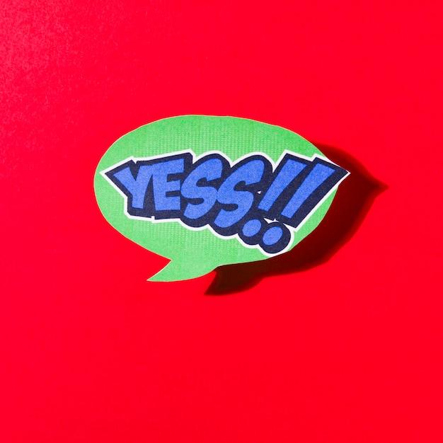 Sim balão verde em quadrinhos sobre fundo vermelho Foto gratuita