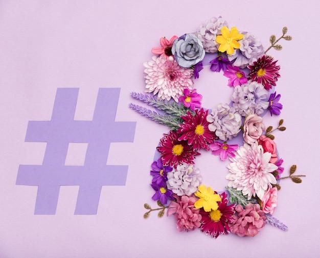Símbolo do dia da mulher floral colorido Foto gratuita