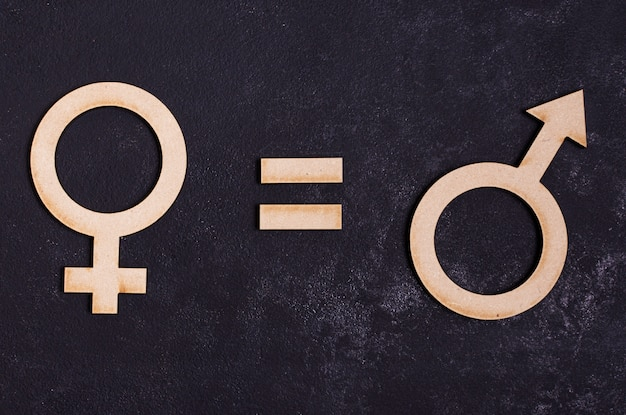 Símbolos de gênero homem é igual a símbolo de gênero feminino Foto gratuita