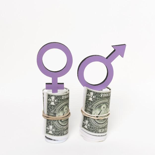 Símbolos de gênero na vista frontal do dinheiro Foto gratuita