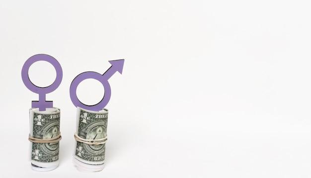 Símbolos de gênero no espaço da cópia de dinheiro Foto gratuita