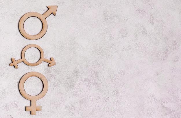 Sinais de gênero em fundo de mármore com espaço de cópia Foto gratuita