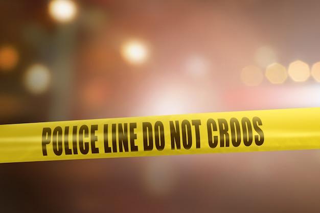 Sinal de fita amarela polícia linha para cena de crime de proteção Foto Premium