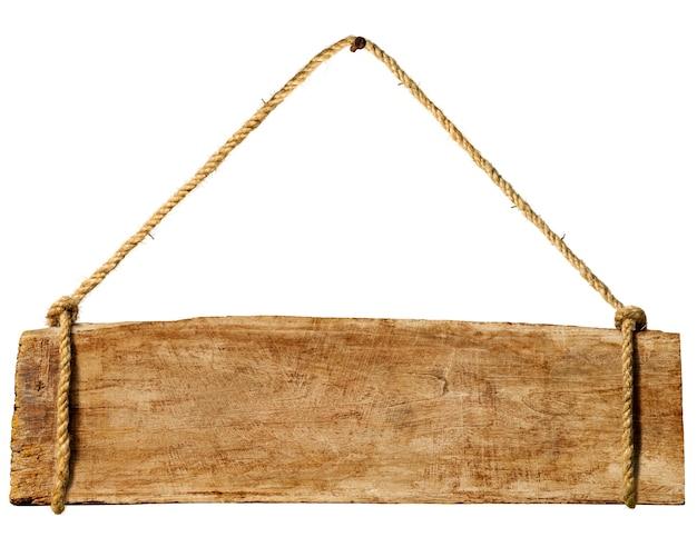 Sinal de madeira que pendura de um prego oxidado. Foto gratuita