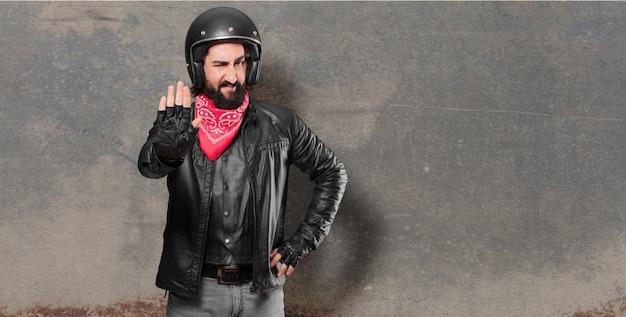 Sinal de parada de piloto de moto Foto Premium