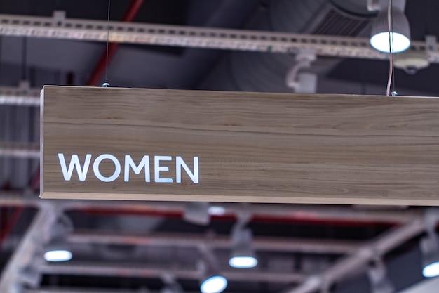 Sinal do departamento de mulheres Foto Premium