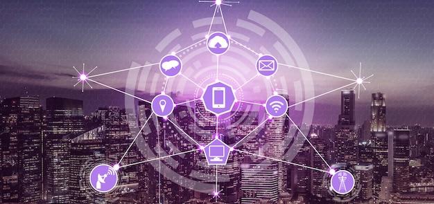 Skyline da cidade inteligente com ícones de rede de comunicação sem fio. conceito de iot internet das coisas. Foto Premium
