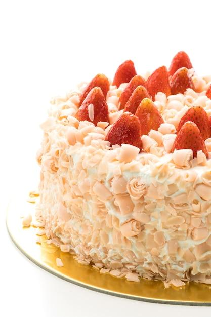 Sobremesa de bolo de baunilha com morango no topo Foto gratuita