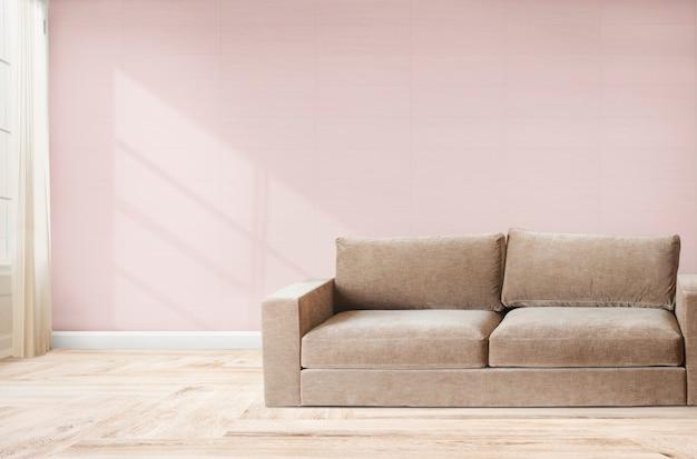 Sofá em um quarto rosa Foto gratuita