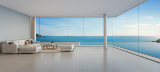 Sofá grande no piso de madeira, perto da janela de vidro e piscina com terraço no apartamento de cobertura. Foto Premium