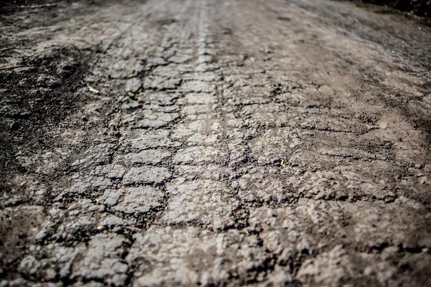 Solo seco árido, terra seca. racha no chão por falta de água Foto Premium