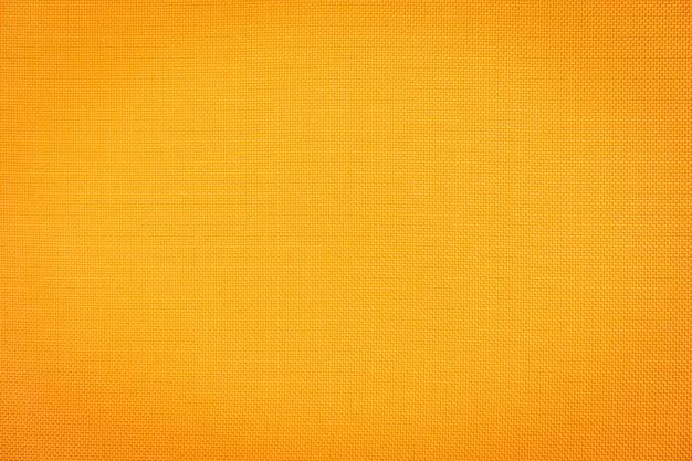 Superfície abstrata e texuture de texturas de tecido de algodão laranja Foto gratuita